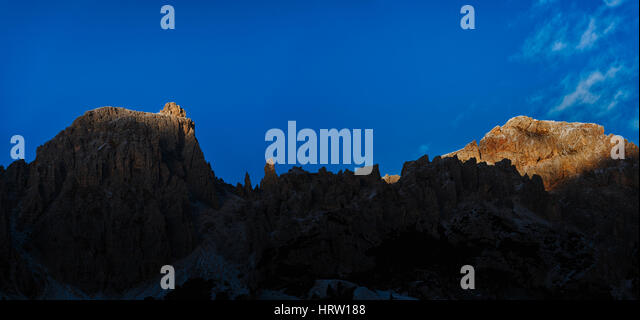 last rays of Sun on the top of Cir Group, Dolomites - Stock Image