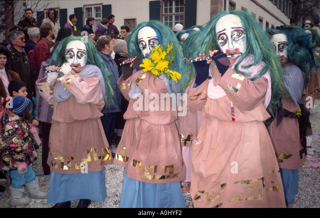 Switzerland Basel Fastnacht carnival flute players in costumes in traditional parade - Stock Image