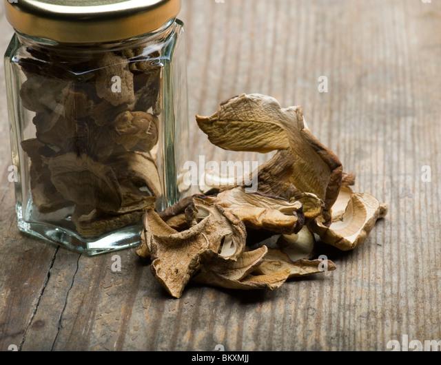 Dried Porcini Mushrooms With Storage Jar - Stock Image