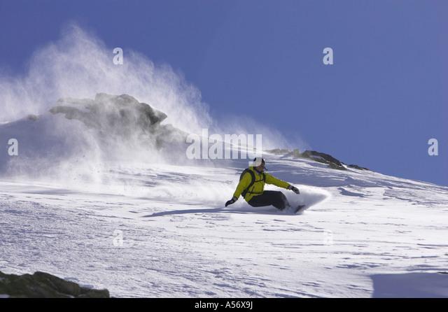 Switzerland, St. Moritz, person snowbording - Stock Image