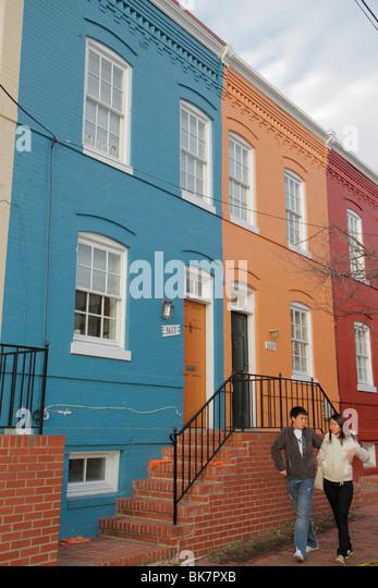 Washington DC Georgetown Prospect Street historic neighborhood row house college town gentrification Asian man woman - Stock Image