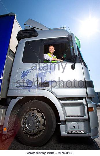 Truck driver driving semi-truck - Stock Image