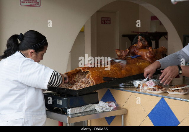 Lechona, stuffed pig with rice and meat, Bogota, Colombia - Stock Image