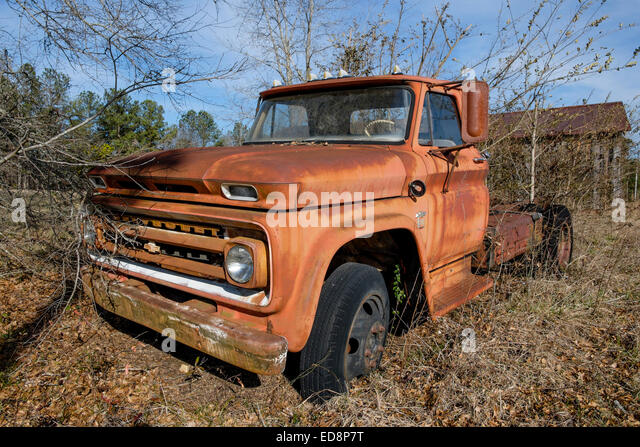 Abandoned 1960s vintage Chevy C10 truck in a rural Alabama field. - Stock Image