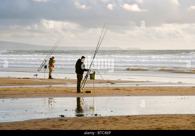 Fishermen at Sandy Mouth near Bude, Cornwall, UK - Stock Image