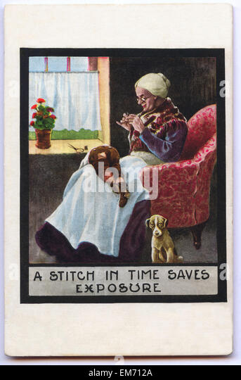Vintage postcard depicting a grandma stitching  her grandson's pants - Stock Image