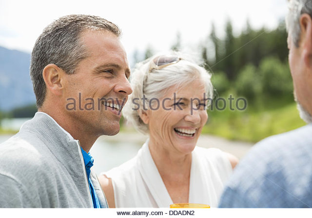 Mature friends having fun - Stock Image