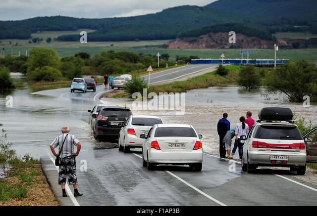 Primorye Territory, Russia. 31st Aug, 2015. The River Razdolnaya overflows and floods a section of the motorway - Stock Image