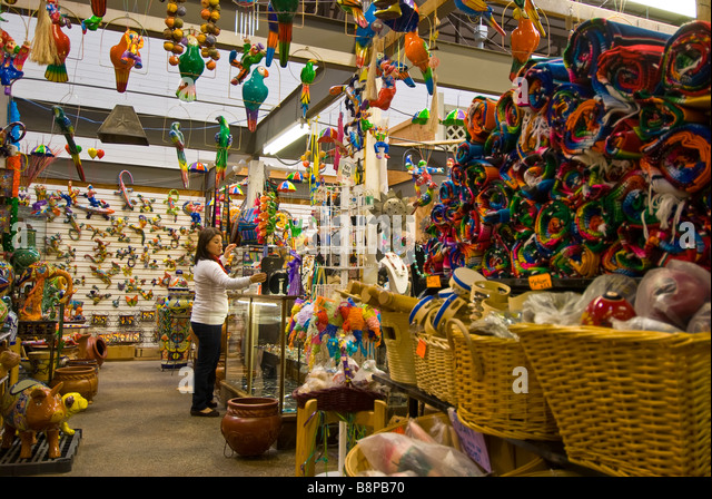 El Mercado woman clerk huge landmark Mexican shopping mall mexican souvenirs arts crafts Historic Market Square - Stock Image