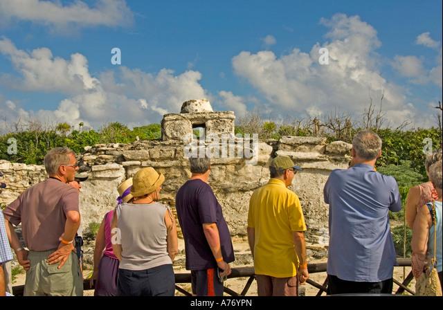 Cozumel Mexico Punta Sur Park Ecological Reserve tourists at El Caracol temple - Stock Image