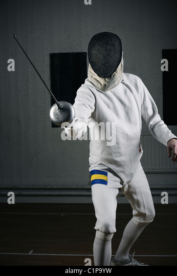 Male fencer in sports hall - Stock Image