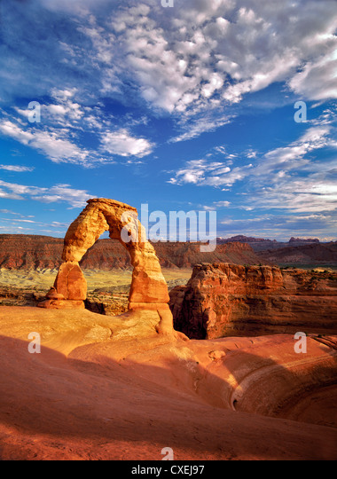 Delicate Arch and clouds. Arches National Park, Utah. - Stock Image
