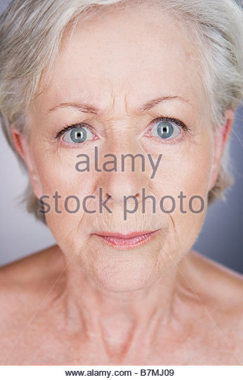 A senior woman looking anxious - Stock Image