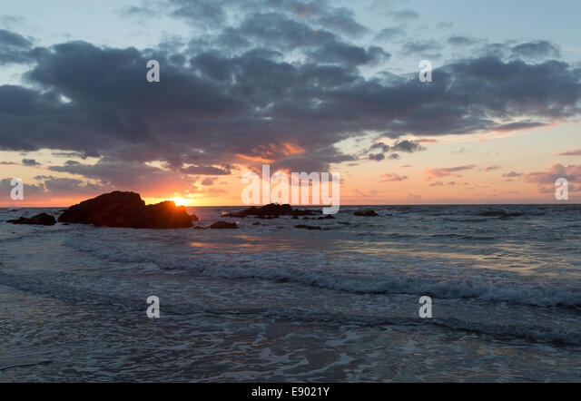 The Wales Coastal Path in North Wales. Picturesque view of sunset at Church Bay beach on the west coast of Anglesey. - Stock Image