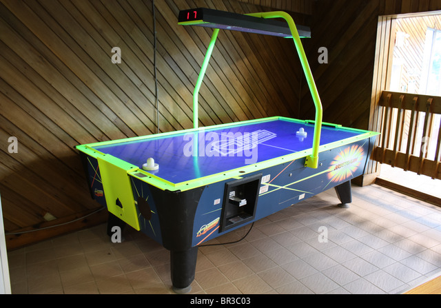 air hockey table hotel game room - Stock Image