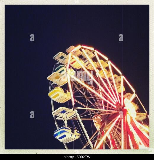 An amusement park Ferris wheel at night - Stock Image