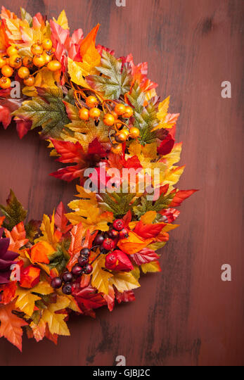 handmade diy artificial autumn wreath decoration with leaves berry flower - Stock Image