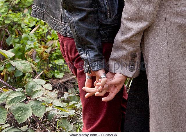 Man and woman holding hands. - Stock-Bilder