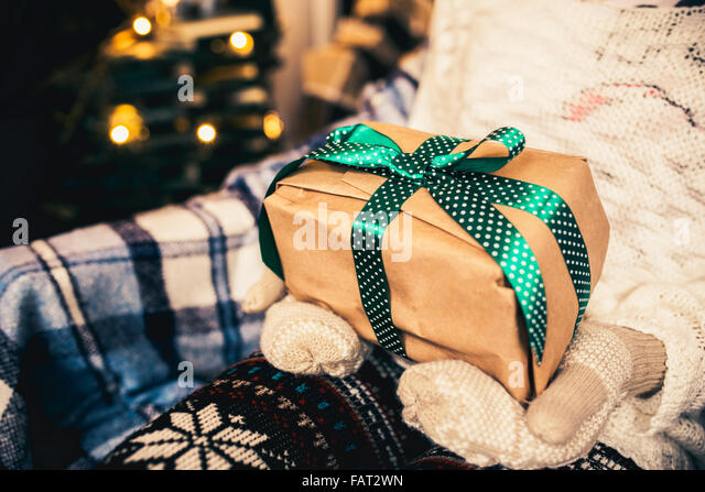 Girl opens a wonderful vintage gift - Stock-Bilder