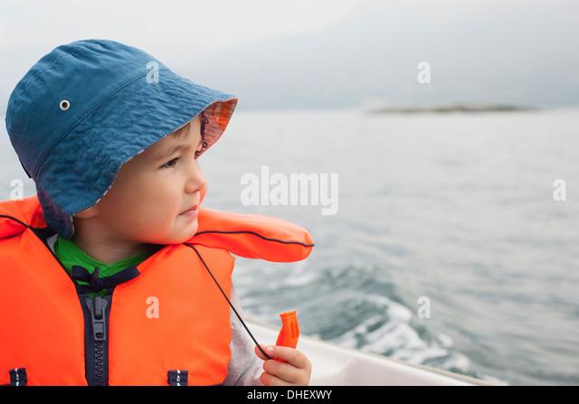 Boy enjoying boat ride - Stock Image