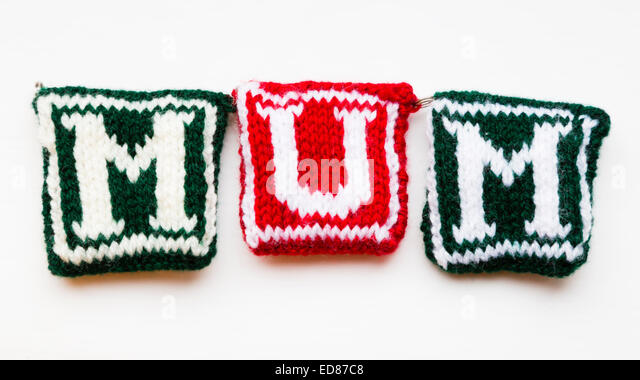 "Knitted woollen lettering spelling ""Mum"" - Stock Image"