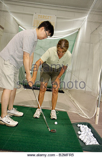 Indiana Valparaiso Creekside Golf Course and Training Center Department of Parks and Recreation man woman putting - Stock Image