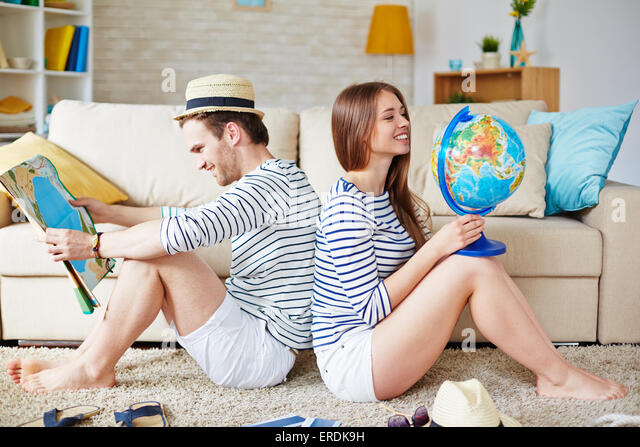 Young couple thinking of where to go traveling - Stock Image