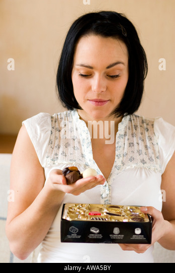 Woman with box of chocolates - Stock Image