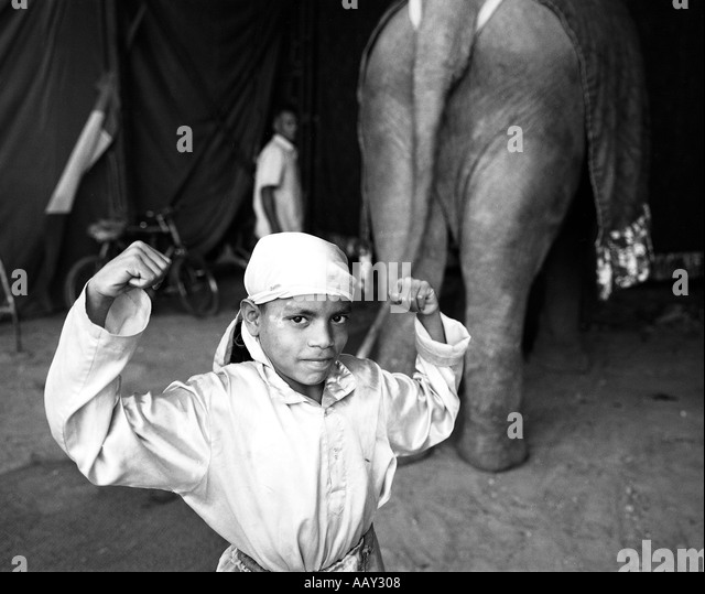 Young artist posing for the camera back stage The Apollo circus artists earn their money through entertainment Behind - Stock-Bilder