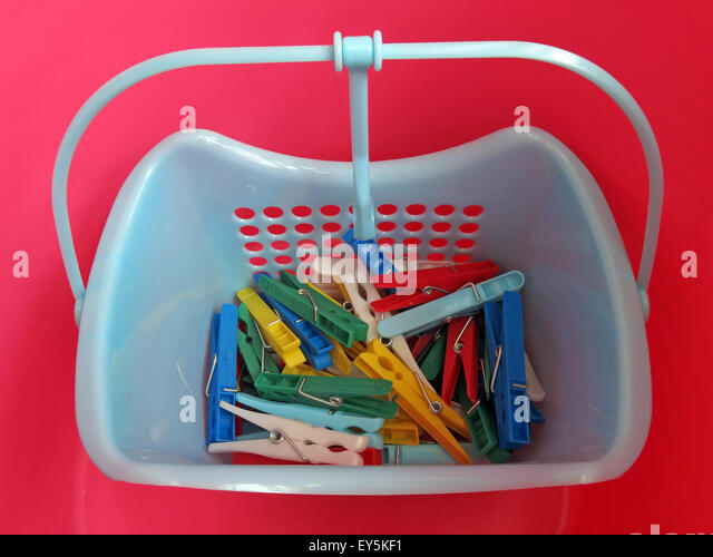 Bright Washday clothes pegs for washing line, in red,blue, yellow,green basket - Stock Image