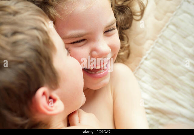 Close-up of brother and sister playing - Stock Image