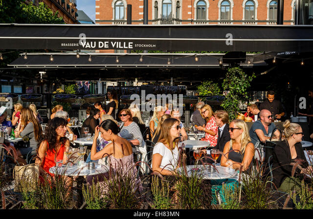 People sitting at a restaurant, Stockholm, Sweden, Scandinavia, Europe - Stock Image