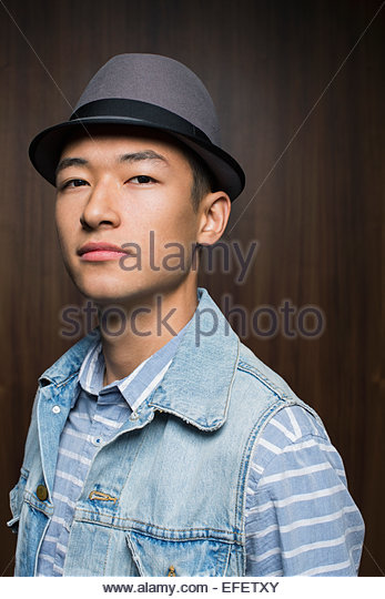 Portrait of cool man wearing fedora - Stock Image