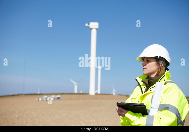 Wind farm and female project manager - Stock Image
