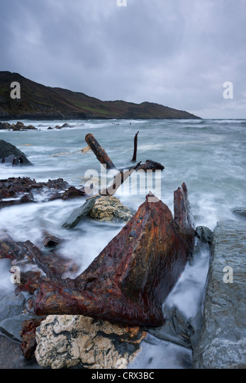Rusted remains of the shipwrecked SS Collier at Rockham Bay near Morte Point, North Devon, England. Spring (April) - Stock Image