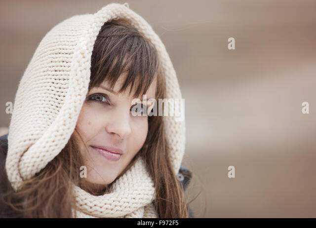 Portrait of woman with hood on in autumn country - Stock-Bilder
