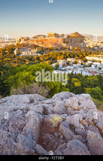 Evening view of Acropolis from Filopappou hill in central Athens. - Stock Image