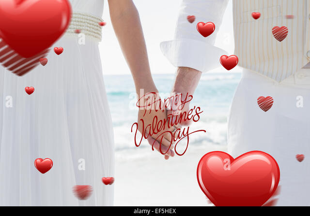 Composite image of newlyweds holding hands - Stock Image