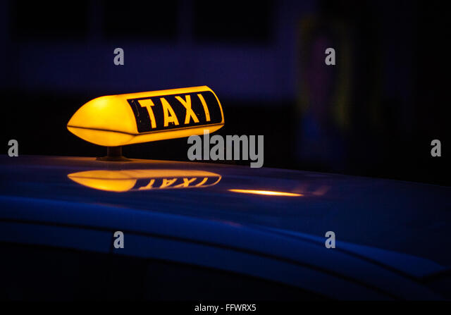 Illuminated Taxi Light At Night - Stock-Bilder