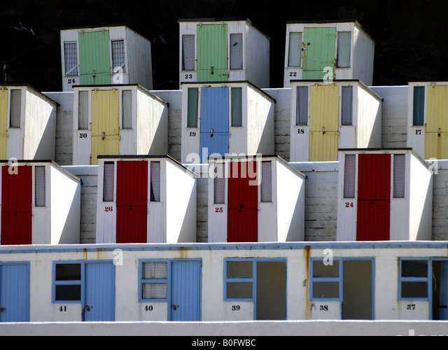 Run down old beach huts at Tolcarne beach, Newquay, Cornwall, UK - Stock Image