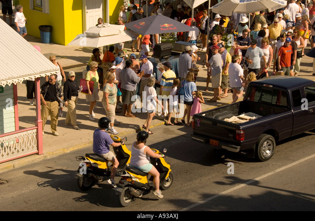 Grand Cayman George Town traffic jam  motor scooter crowd overcrowded - Stock Image