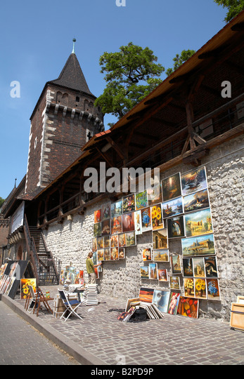 Poland Krakow oil paintings hanging on city walls close to Florian Gate - Stock-Bilder