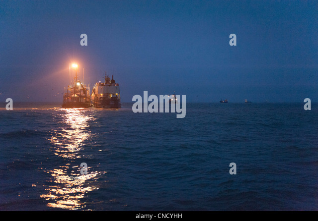 Nighttime view of a floating processor facility at anchor in Ugashik Bay in the Bristol Bay region, Southwest Alaska, - Stock Image