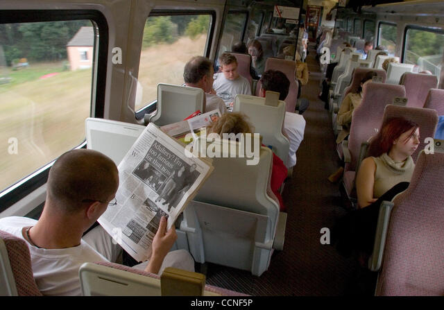 Oct 05, 2004; London, UK; Travellers and passengers on the train from London to Leeds enjoy reading newspapers and - Stock Image