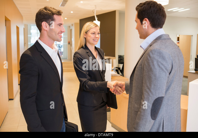 Businesswoman businessman office happy handsome - Stock Image