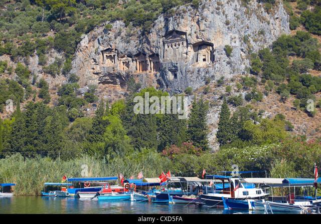 Lycian tombs of Dalyan with fishing and tourists boats below, Dalyan, Anatolia, Turkey, Asia Minor, Eurasia - Stock Image