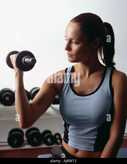 Young woman weightlifting - Stock Image