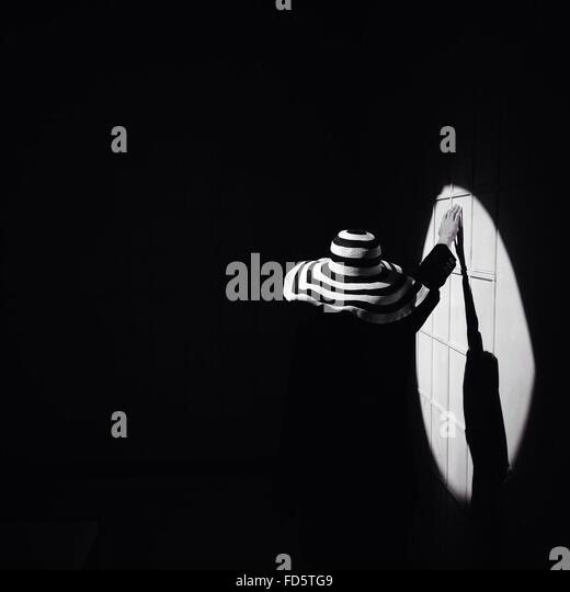 Shadow Of Woman On Wall - Stock Image