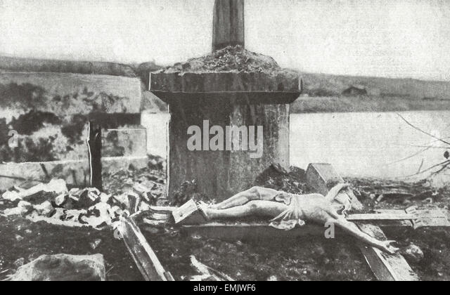 A triumph of German Gunnery - The Crucifix was thrown down by a shell, but the figure remained intact - WWI - Stock Image