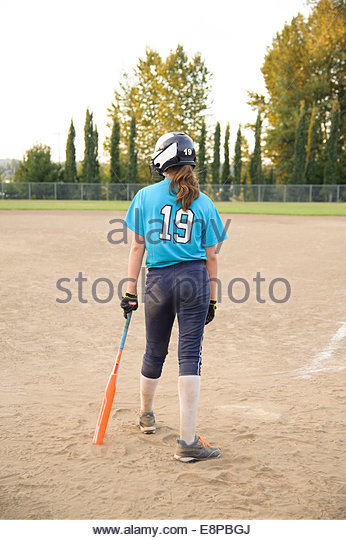Girl (13-15) playing baseball - Stock-Bilder